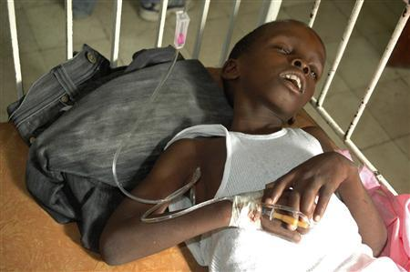 A boy suffering from cholera sleeps while waiting for medical treatment at a local hospital in the Marchand Dessaline zone, about 36 km (22 miles) from the town of Saint Marc, October 22, 2010. REUTERS/St-Felix Evens