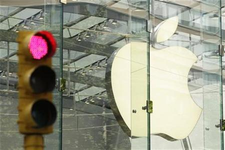 The Apple logo shines inside of an Apple Store in New York July 19, 2010. REUTERS/Lucas Jackson