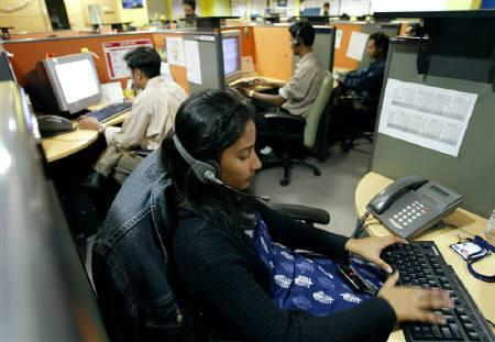 Indian employees at a call centre provide service support to international customers, in Bangalore March 17, 2004. REUTERS/Sherwin Crasto/Files