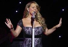 <p>Mariah Carey durante show para acionistas do Wal-Mart, nos EUA. A cantora disse nesta quinta-feira que estava grávida de seu primeiro filho. 04/07/2010 REUTERS/Sarah Conard</p>