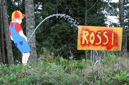 A roadside sign depicts a little boy urinating on a mock campaign sign promoting Republican Senatorial candidate Dino Rossi, alongside State Route 530 in rural Washington State, October 2, 2010. Rossi is vying for the Senate position held by 18-year incumbent Democrat Patty Murray. REUTERS/Anthony Bolante