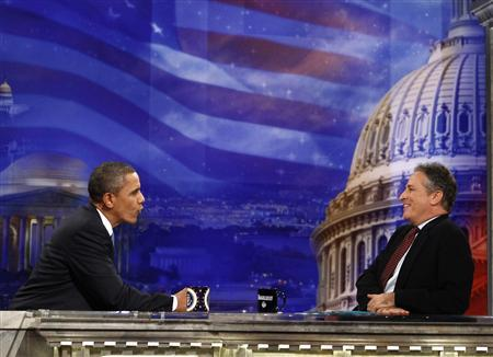 U.S. President Barack Obama speaks with Jon Stewart during a break in the taping of an interview for the Daily Show in Washington, October 27, 2010. REUTERS/Jim Young