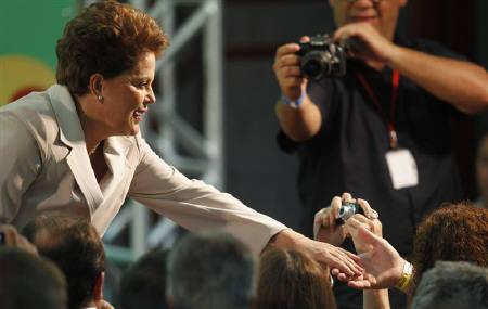 Brazil's presidential-elect Dilma Rousseff  greets supporters before speaking in Brasilia October 31, 2010. Former guerrilla leader Rousseff won Brazil's presidential election in resounding fashion after promising to stick to policies that have lifted millions from poverty and made Brazil one of the world's hottest economies. REUTERS/Bruno Domingos