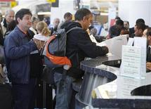<p>People wait in line to check in for international flights inside Terminal 1 at John F. Kennedy Airport in New York April 19, 2010. REUTERS/Shannon Stapleton</p>