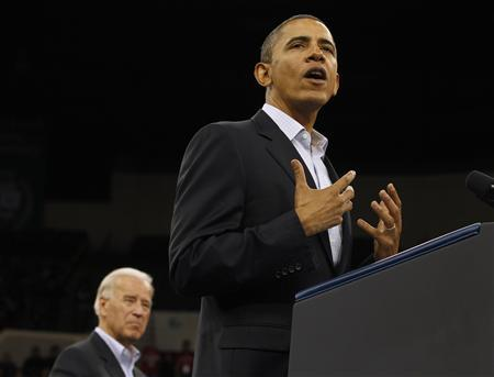 President Barack Obama and Vice President Joseph Biden attend a DNC Moving America Forward Rally at Cleveland State University in Ohio, October 31, 2010. REUTERS/Larry Downing