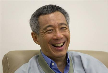 Singapore's Prime Minister Lee Hsien Loong laughs during an interview with Reuters in his office at the Istana in Singapore November 2, 2010. Singapore needs the United States and China to work out their differences to ensure prosperity, its prime minister said on Tuesday. REUTERS/Vivek Prakash