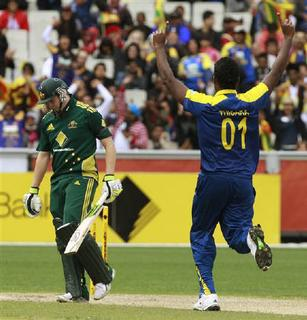 Sri Lanka's Thisara Perera (R) celebrates after dismissing Australia's Steven Smith in their One Day International cricket match in Melbourne November 3, 2010. REUTERS/Mick Tsikas