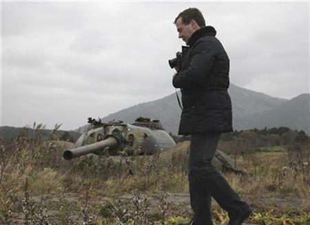 Russia's President Dmitry Medvedev take pictures during his visit to Kunashiri Island, one of four islands known as the Southern Kuriles in Russia and Northern Territories in Japan, November 1, 2010. REUTERS/Ria Novosti/Kremlin/Mikhail Klimentyev
