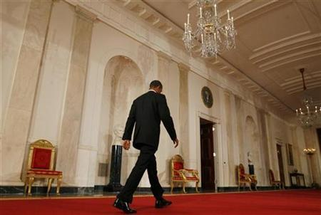 President Barack Obama departs down the cross hall of the White House after concluding his post-election news conference in the East Room in Washington, November 3, 2010. REUTERS/Larry Downing