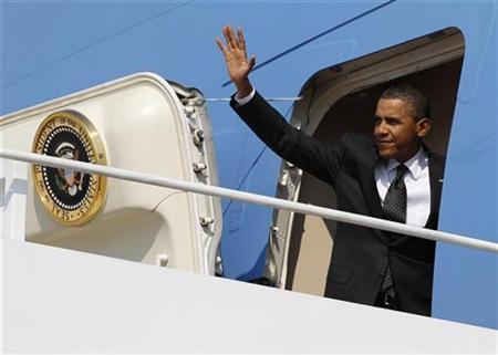 President Barack Obama waves from Air Force One at Andrews Air Force Base near Washington, September 22, 2010. REUTERS/Jason Reed