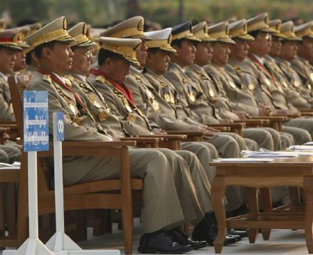 Myanmar's General Thura Shwe Man (L), the third most powerful leader of the regime, Prime Minister General Thein Sein (2nd L) and military officers watch a march past during the Armed Forces Day ceremony at Naypyitaw March 27, 2010.  REUTERS/Soe Zeya Tun/Files