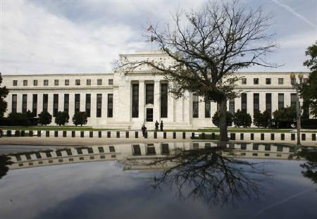 The Federal Reserve Building is reflected on a car in Washington September 16, 2008. REUTERS/Jim Young/Files
