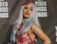 <p>Lady Gaga, wearing an outfit made of meat, poses in the photo room after winning eight awards at the 2010 MTV Video Music Awards in Los Angeles, California September 12, 2010. REUTERS/Mario Anzuoni (UNITED STATES- Tags: ENTERTAINMENT)</p>