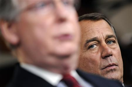 House Republican Leader John Boehner (R-OH) (R) listens to Senate Minority Leader Mitch McConnell (R-KY) (L) answer questions during a news conference after sweeping Republican gains in midterm elections, at the U.S. Capitol in Washington, November 3, 2010. REUTERS/Jonathan Ernst