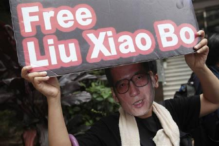 A pro-democracy protester wearing a mask of jailed Chinese democracy activist Liu Xiaobo attends a protest urging for the release of Liu and political prisoners, outside the Chinese liaison office in Hong Kong October 11, 2010. REUTERS/Tyrone Siu/Files