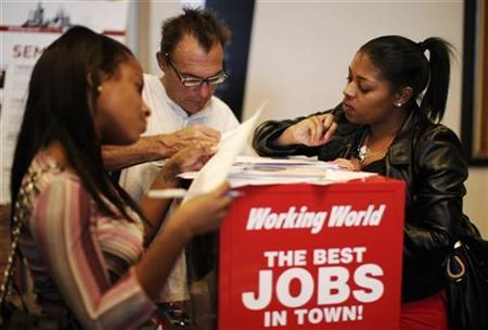People fill out job application forms at a job fair in Los Angeles, California, October 13, 2010. REUTERS/Lucy Nicholson