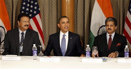 U.S. President Barack Obama (C) sits next to Ajay Piramal (L) and Anand Mahindra during a meeting with entrepreneurs in Mumbai, India, November 6, 2010. REUTERS/Jason Reed