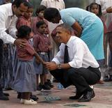 <p>U.S. President Barack Obama and first lady Michelle Obama greet the children of workers who restore New Delhi's historical buildings, as they tour Humayun's tomb in New Delhi November 7, 2010. REUTERS/Jason Reed</p>