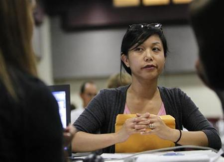 Helen Ramos of Fairfield, California, listens to an advisor during a counselling event for homeowners applying for mortgage modifications in Oakland, California, August 13, 2010. REUTERS/Robert Galbraith