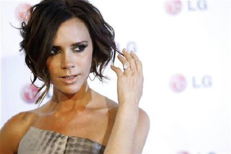 Host Victoria Beckham poses at the LG Fashion Touch party in West Hollywood, California, May 24, 2010. REUTERS/Mario Anzuoni