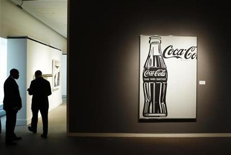 Security guards stand near ''Coca-Cola [4] Large Coca-Cola'' by Andy Warhol during a preview of Sotheby's Impressionist & Modern Art auction in New York October 29, 2010. REUTERS/Lucas Jackson