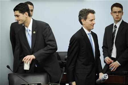 Treasury Secretary Timothy Geithner crosses paths with Rep. Paul Ryan as he arrives to testify before the House Budget Committee on Capitol Hill, March 5, 2009. REUTERS/Jonathan Ernst