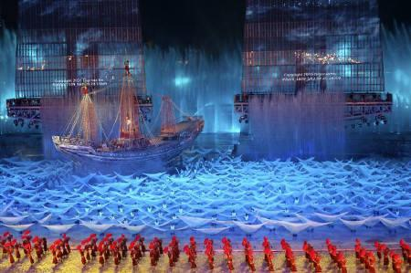 Participants perform during a rehearsal for the opening ceremony of the Asian Games in Guangzhou, Guangdong province November 9, 2010. REUTERS/Stringer