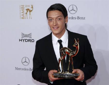 German national soccer player Mesut Oezil poses with his trophy in Integration category during the 62nd Bambi media awards ceremony in Potsdam November 11, 2010. REUTERS/Thomas Peter