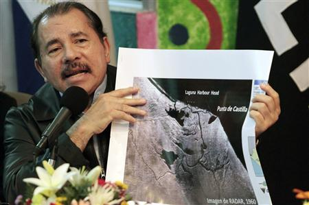 Nicaragua's President Daniel Ortega shows a map referring to the territorial dispute with Costa Rica during an address to the nation in Managua November 13, 2010. REUTERS/Oswaldo Rivas