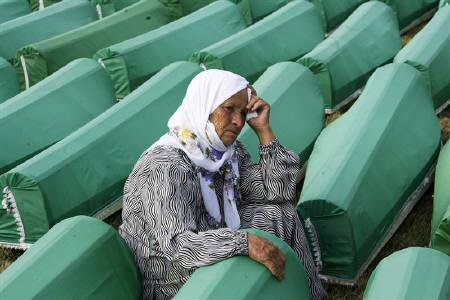 A Muslim woman mourns by the coffin of her relative, one of 775 newly identified victims of the 1995 Srebrenica massacre, during a joint burial in Potocari July 11, 2010. REUTERS/Danilo Krstanovic