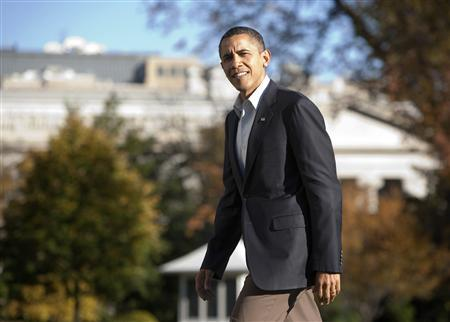 President Barack Obama walks to the White House in Washington November 14, 2010. REUTERS/Joshua Roberts