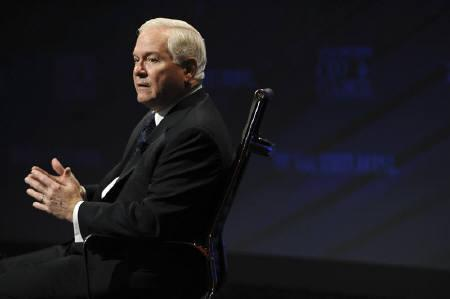 U.S. Defence Secretary Robert Gates answers questions during an onstage interview at the 2010 meeting of the Wall Street Journal CEO Council in Washington, November 16, 2010. REUTERS/Jonathan Ernst