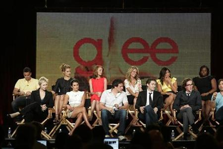 Cast members of the new series ''Glee'' discuss the show at the Fox Summer Television Critics Association press tour in Pasadena, California in this August 6, 2009 file photo. Hulu Plus, which made its official debut on Wednesday, offers subscribers access to premium content, including current hit TV shows ''Glee,'' ''30 Rock,'' and ''Modern Family,'' through a variety of devices including Apple iPad and Sony's PlayStation 3. REUTERS/Fred Prouser