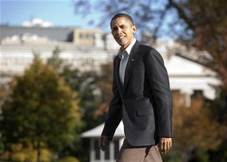 President Barack Obama walks to the White House in Washington November 14, 2010. REUTERS/Joshua Roberts