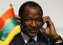 <p>Burkina Faso's President Blaise Compaore adjusts headphones during a news conference at the United Nations Climate Change Conference 2009 in Copenhagen December 17, 2009. REUTERS/Christian Charisius</p>
