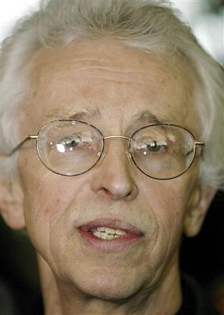 Siegfried Hecker a member of a U.S. delegation that visited North Korea's Yongbyong nuclear complex, speaks to the media upon their arrival in Beijing in this January 10, 2004 file photo. REUTERS/Andrew Wong/Files