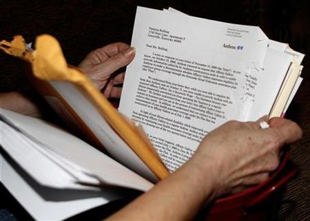A woman looks over the letter from Anthem Insurance as she works through her breast cancer issues at her home in Louisville, Kentucky, April 21, 2010. REUTERS/John Sommers II