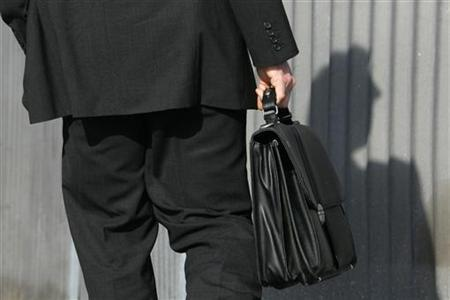 A man carries a briefcase in a file photo. REUTERS/File