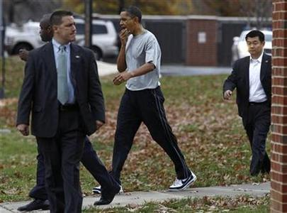 President Barack Obama walks back to his car after playing basketball at Fort McNair in Washington, November 26, 2010. REUTERS/Jim Young