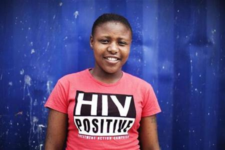 Nandi Makhele, 25, poses for a portrait while wearing a T-shirt indicating that she is HIV-positive, in Cape Town's Khayelitsha township February 15, 2010. REUTERS/Finbarr O'Reilly