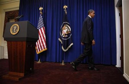 President Barack Obama leaves the lecturn following remarks speaks about federal worker wage freezes in the Eisenhower Executive Office Building near the White House in Washington, November 29, 2010. REUTERS/Jason Reed