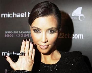 Reality TV star Kim Kardashian models a 22 karat princess cut diamond ring during the launch of the Michael Hill Jeweller's Ultimate Engagement Ring Search for the World's Best Couple in Toronto October 18, 2010. REUTERS/Mike Cassese