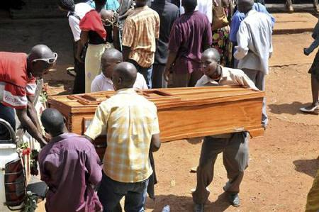 File photo of a Ugandan family loads a coffin of a relative killed in bomb blasts from Mulago Hospital for burial, in Kampala July 13, 2010. REUTERS/Ronald Kabuubi/Files