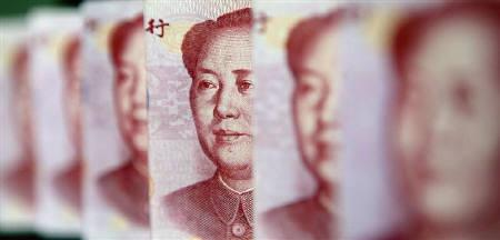 Yuan banknotes are seen in this illustrative photograph taken in Beijing July 26, 2010. REUTERS/Jason Lee/Files