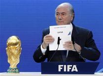 <p>FIFA President Sepp Blatter announces Qatar as the host nation for the FIFA World Cup 2022, in Zurich December 2, 2010. REUTERS/Christian Hartmann</p>