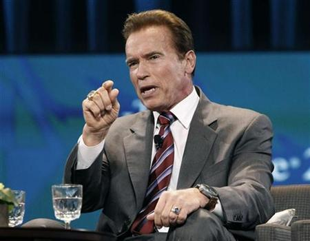 Current California Govermor Arnold Schwarzenegger gestures during his appearance at the Women's Conference 2010 in Long Beach, California, October 26, 2010. REUTERS/Mario Anzuoni