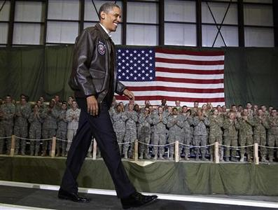 President Barack Obama arrives to address troops at Bagram Air Base December 3, 2010. Obama, paying a surprise visit to Afghanistan on Friday, praised U.S. troops for their sacrifice and ''important progress'' in a nine-year war that is increasingly unpopular at home. REUTERS/Jim Young