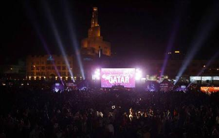 People celebrate after FIFA announced that Qatar will be host of the 2022 World Cup in Souq Wakif in Doha, December 2, 2010. REUTERS/Fadi Al-Assaad