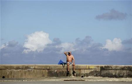 A tourist sunbathes on Havana's seafront boulevard 'El Malecon' November 25, 2010. REUTERS/Desmond Boylan