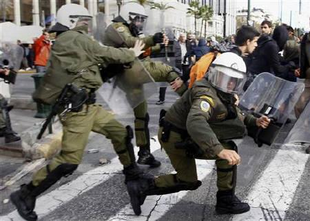 Riot policemen chase away students during a protest in central Athens, December 6, 2010. REUTERS/Yannis Behrakis